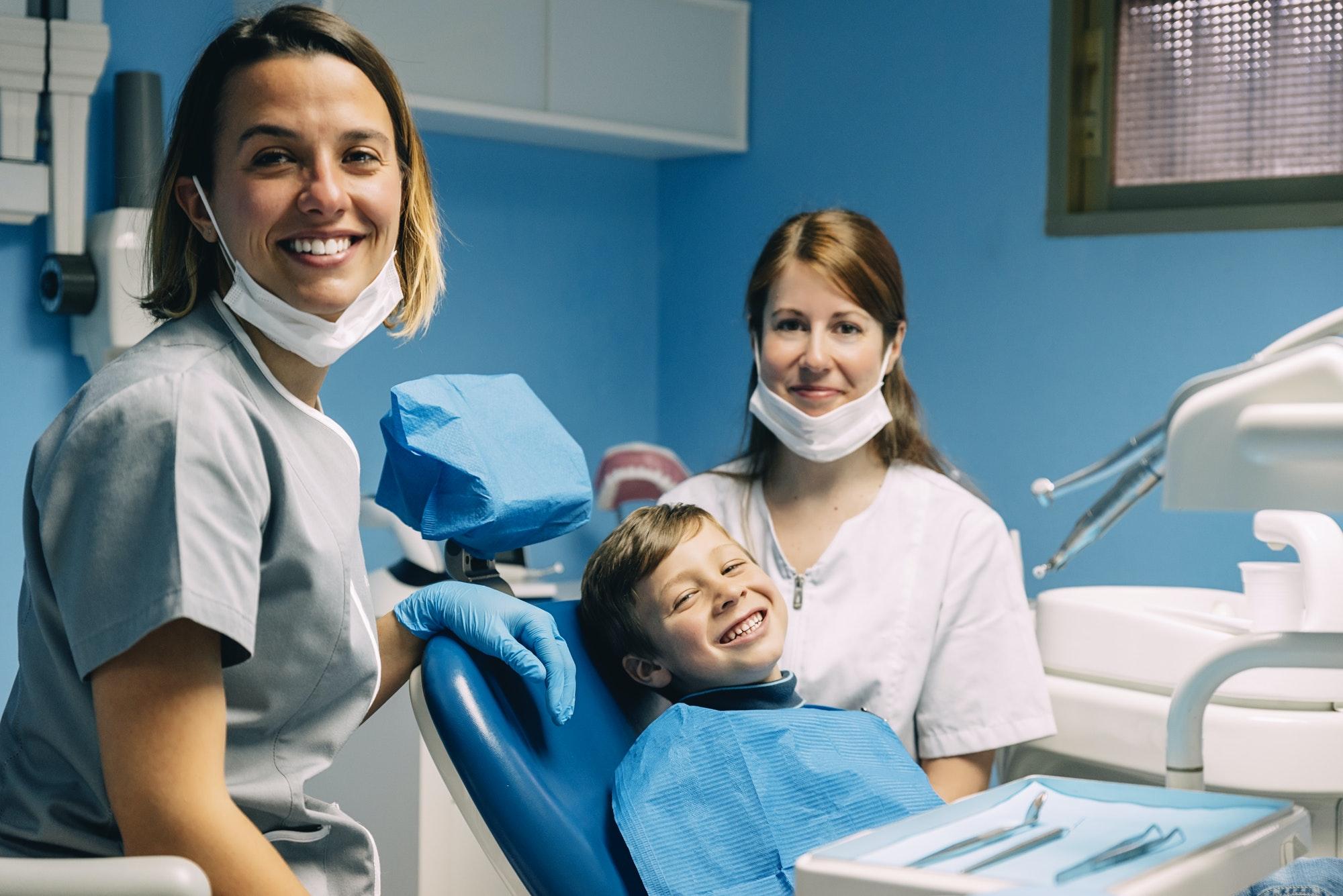 Portrait of dentists and child patient.